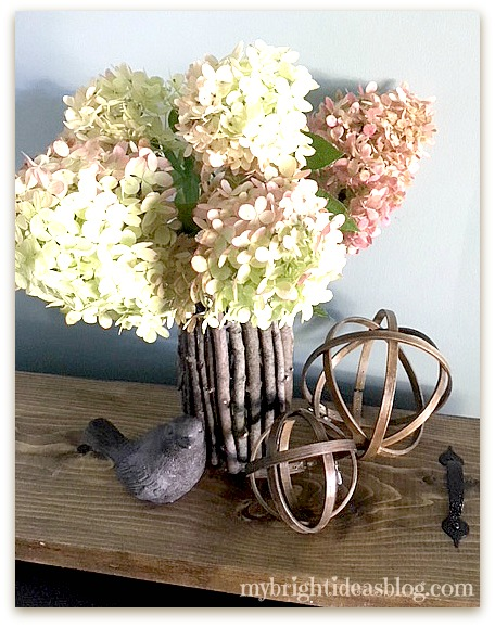 How to turn a plain vase into a rustic twig vase or candle holder. Easy diy craft. mybrightideasblog.com