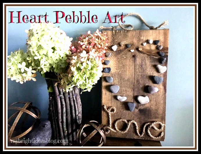 Collect Beach Stones in Heart Shape to creat this pebble and jute rope hanging wall decoration. Great gift idea! mybrightideasblog.com