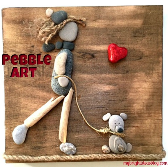 How to make easy art with pebbles. Use a board and small stones and rope to make a girl walking her dog from rocks. mybrightideasblog.com
